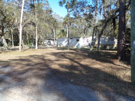 Ellis 1/2 acres with mobile and sheds IN SUWANNEE UNDER CONTRACT